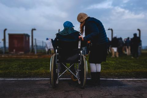Elder person with family member